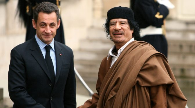 france-s-president-nicolas-sarkozy-greets-libyan-leader-muammar-gaddafi-in-the-courtyard-of-the-elysee-palace-in-paris